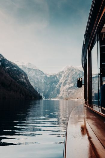 On the boat 🚣‍♀️ Boat Ride Boats Winter Transportation Mountain Mode Of Transportation Water Nature Beauty In Nature Scenics - Nature Sky Mountain Range Car Travel No People Reflection Land Vehicle Day Snow Road Motor Vehicle Outdoors Road Trip