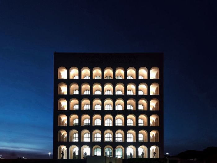 Low angle view of illuminated building against clear blue sky