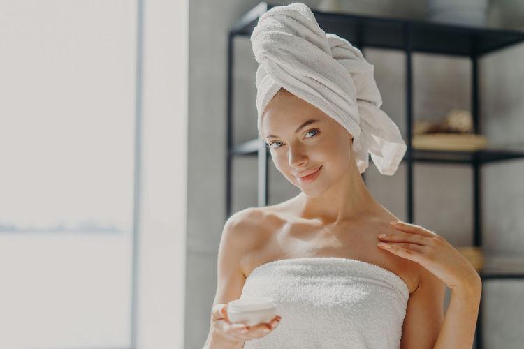 Portrait of woman in bathroom