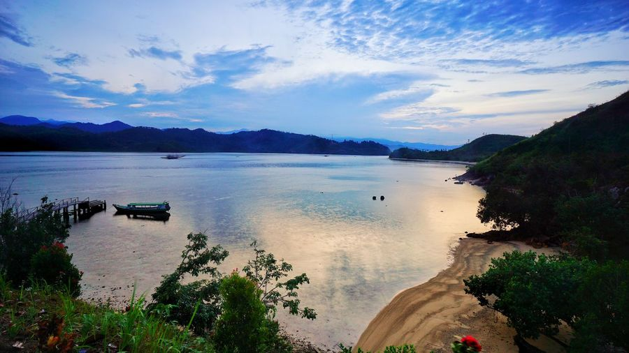 The sunrise in from the peak of Labuan Sunday hill in Mandeh, Pesisir Selatan, Sumatera Barat, Indonesia. Beautiful Indonesia, .... Like Like4like INDONESIA Travel Travel Destinations Travel Photography SumateraBarat Indonesia_photography Scenics Scenic View Scenic Photograghy Mandeh Teluk Mandeh Seascape Photography Island View  Beach Photography Clear Clear Water Resort Photogtaphy By Jgawibowo Shot By Aif Wibowo Photography By @jgawibowo Photography By Jgawibowo Photography By Arif Wibowo Sunrise Water Tree Mountain Beach Lake Blue Sunset Reflection Sky Cloud - Sky Seascape Horizon Over Water Coast Calm Sea