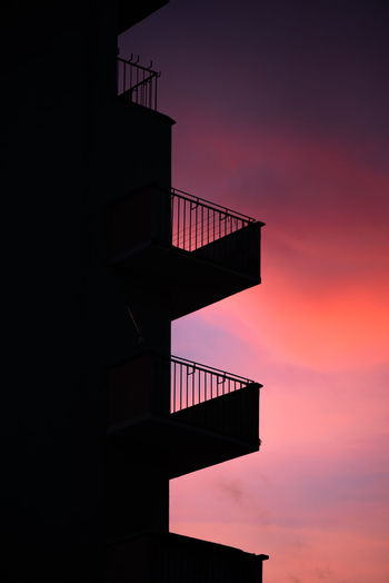 Low angle view of silhouette building against sky during sunset