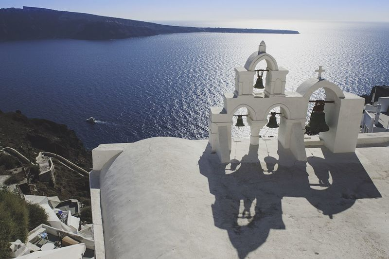 High angle view of church bells against sea