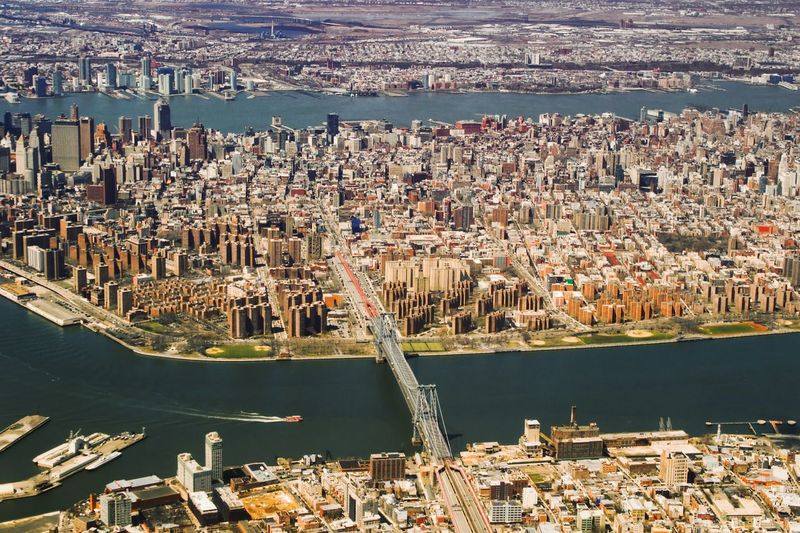 High angle view of manhattan bridge over east river in city