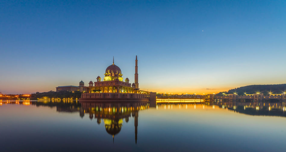 A perfect morning reflection by the Putrajaya lake. Architecture Blue Built Structure Capital Cities  Clear Sky Famous Place History Illuminated International Landmark Malaysia Malaysia Truly Asia Mosque Mosques No People Outdoors Putrajaya Putrajaya, Malaysia Reflection Sky Standing Water Temple - Building Tourism Travel Destinations Water Waterfront