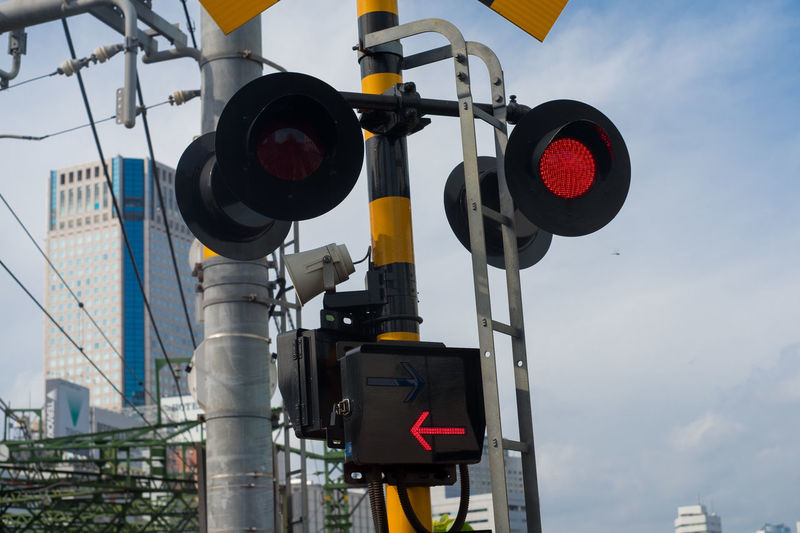 Cloud - Sky Communication Crossing Sign Day Guidance Light Low Angle View Nature No People Outdoors Protection Railway Signal Red Light Road Sign Road Signal Safety Security Sign Signal Sky Stoplight Technology