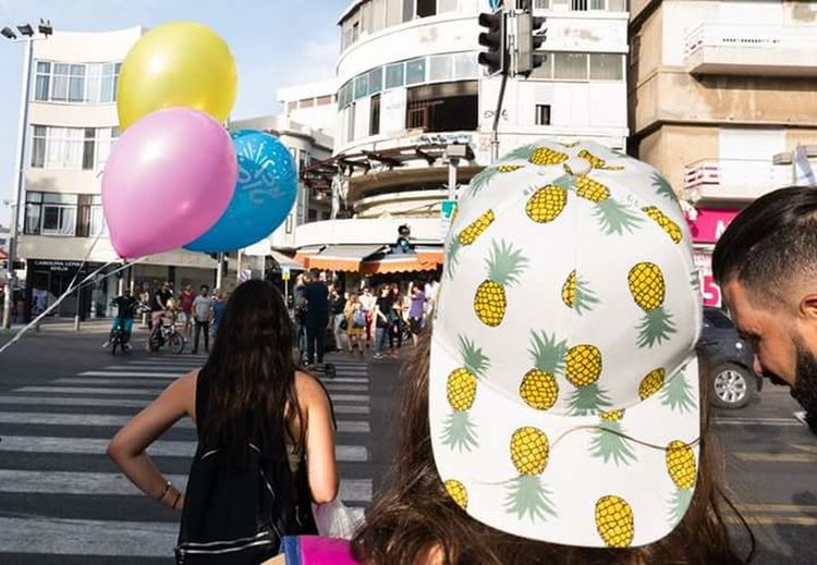 2018 EyeEm Streetphotgraphy Awards The Street Photographer 2018 Eyem Awards The Street Photographer - 2018 EyeEm Awards City Balloon Helium Balloon Young Women Multi Colored Portrait Party - Social Event Women Rear View Looking At Camera 2018 In One Photograph