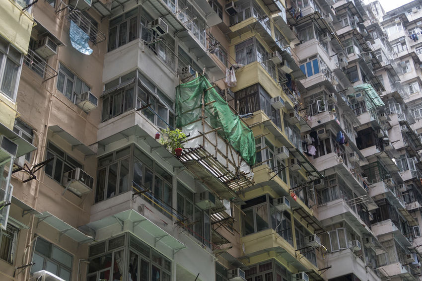 Hong Kong HongKong Apartment Architecture Balcony Building Building Exterior Built Structure City Day Flower Flowering Plant Full Frame Growth Low Angle View Nature No People Outdoors Plant Potted Plant Residential District Window