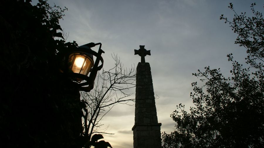 Low angle view of illuminated lamp post against sky