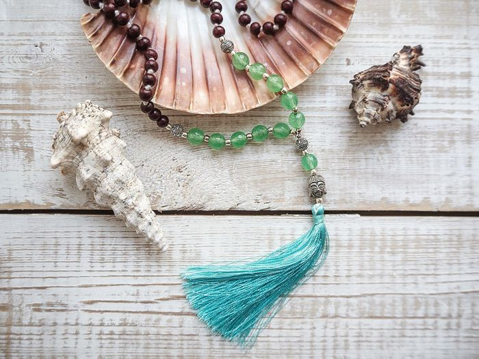 Rosary beads with Buddha hear and sea shells Sandalwood Sea Shells Crystal Ball White Wooden Texture White Wood Rosary Beads Buddha Head Buddha Beads Rosary Wood - Material Table No People Directly Above Jewelry Personal Accessory Close-up