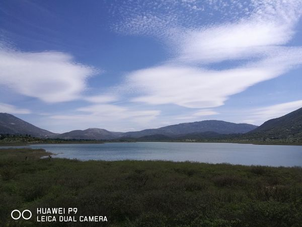 Mountain Lake Landscape Mountain Range Scenics Beauty In Nature Outdoors No People Water Nature Day Flower Sky