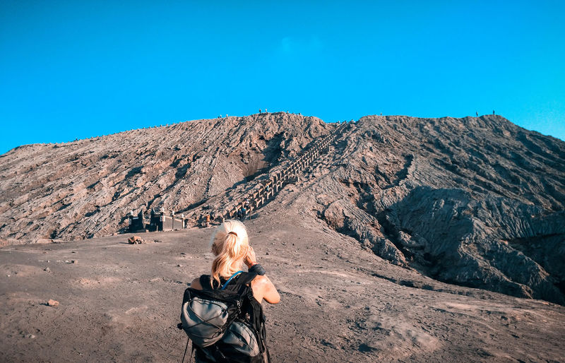 Full length of woman against mountains against clear blue sky