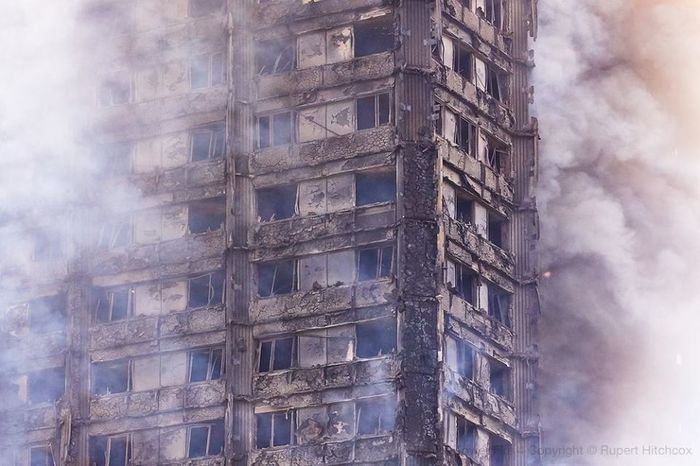 The smoke clears briefly to reveal the burnt shell of Grenfell Tower Architecture Emergencies And Disasters EyeEmNewHere Fire Escape Full Frame Grenfell Tower Grenfell Tower Fire Rupert Hitchcox, Safety