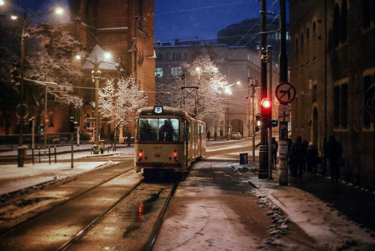 Tram Moving On City Street At Night