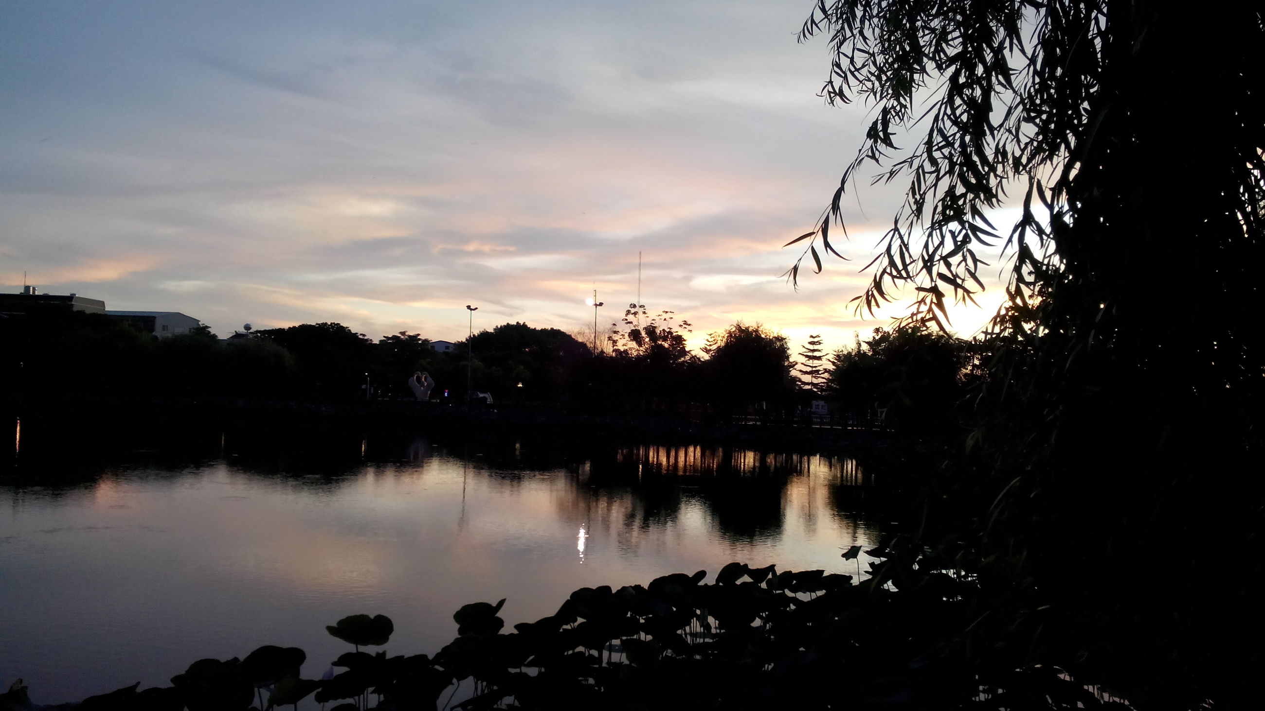 water, sunset, reflection, silhouette, lake, sky, tranquility, tranquil scene, scenics, tree, beauty in nature, cloud - sky, nature, idyllic, cloud, calm, river, outdoors, dusk, orange color