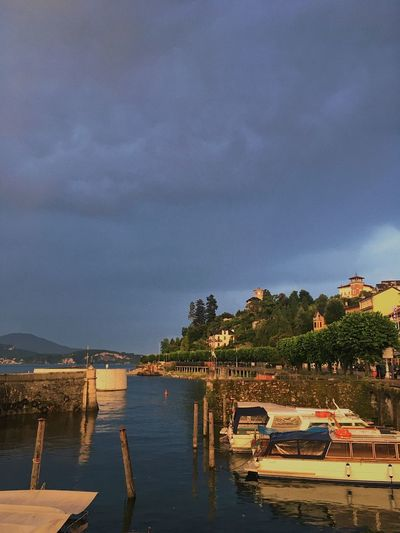 Harbor scene after a storm, Stresa, Italy. Architecture Beauty In Nature Building Exterior Built Structure Cloud - Sky Day Lake Mode Of Transport Moored Mountain Nature Nautical Vessel No People Outdoors Scenics Sky Storm Cloud Tranquility Transportation Tree Water