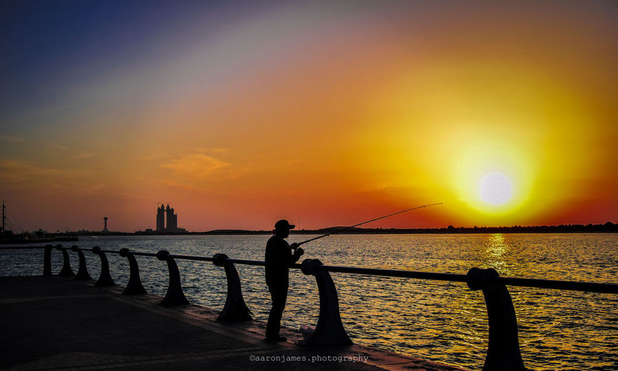 Fish be with you Sunset Sea Water Silhouette Beach Travel Destinations Nature Outdoors Street Photography First Eyeem Photo Firsteyeemphoto Life EyeEmNewHere Lifestyles Uaelife🇦🇪 NIKON D5300 Streetphotography UAE , Dubai Nature Naturephotography Beauty In Nature FirstEyeEmPic Freestyle Breathing Space Investing In Quality Of Life