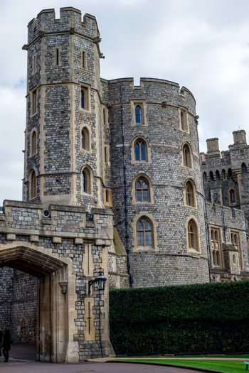 Entrance gate and castle tower at Windsor Castle, county of Berkshire, England Berkshire Charles Elizabeth Great Britain Her Majesty London Monarchy Official Queen Tourist Attraction  United Kingdom Architecture Building Exterior England Historical History Prince  Residence Round Royal Sky Tower Travel Destinations Window Windsor Castle