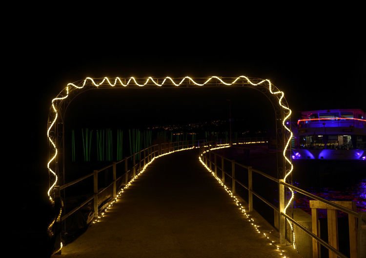 Night Connection Architecture Built Structure Bridge Illuminated Bridge - Man Made Structure Water No People Transportation The Way Forward Nature Direction Railing Sky Travel Destinations Outdoors Glowing Waterfront Footbridge The Creative - 2019 EyeEm Awards