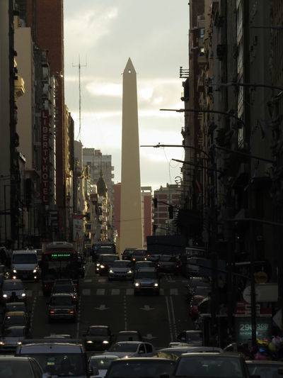 Low angle view of obelisco amidst buildings in city