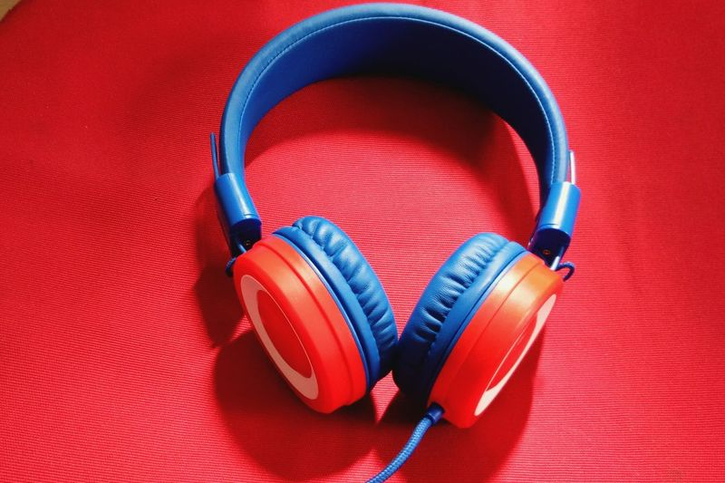 Close-up of headphones on red seat