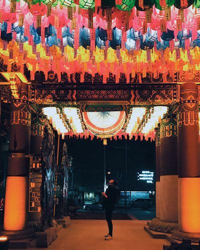 Full frame shot of illuminated lanterns hanging in city at night