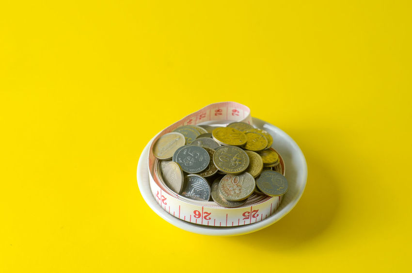 Business Candy Coin Colored Background Copy Space Currency Directly Above Economy Finance Food Food And Drink Indoors  Large Group Of Objects No People Savings Studio Shot Sweet Sweet Food Temptation Wealth Yellow Yellow Background