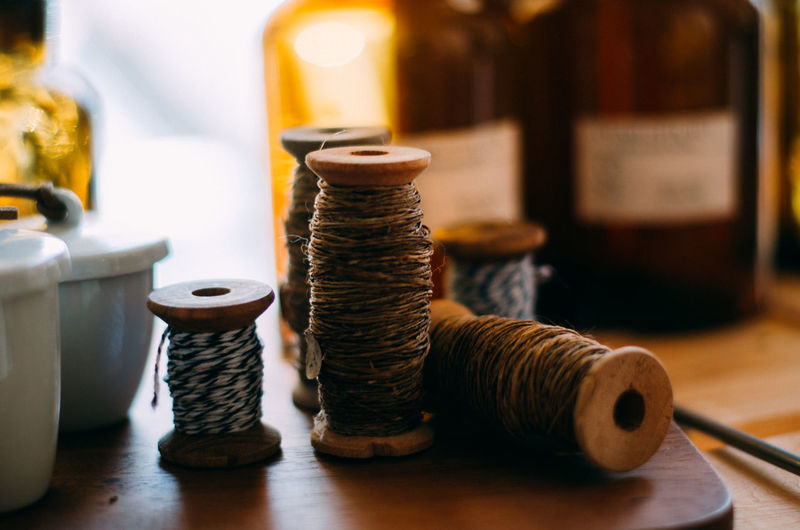 lasso DIY Holiday LINE Rope Activity Balance Bottle Close-up Cup Focus On Foreground Food And Drink Handmade Indoors  Large Group Of Objects Lasso No People Relax Selective Focus Still Life Table Warm Wood - Material