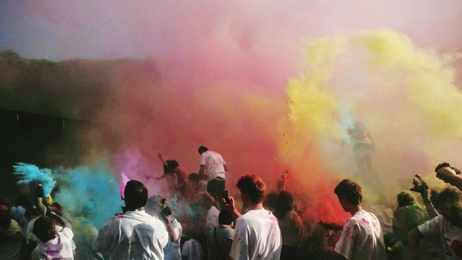 People enjoying with multi colored powder paints in festival