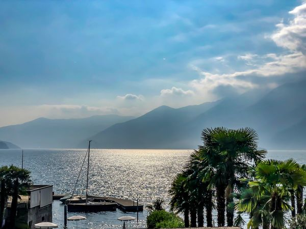 Lago Maggiore - Early Morning Lago Maggiore Ascona Sky Cloud - Sky Beauty In Nature Water Tree Architecture Plant Scenics - Nature Nature Mountain Sea Building Exterior Built Structure No People Day Tranquil Scene Outdoors Growth Tranquility