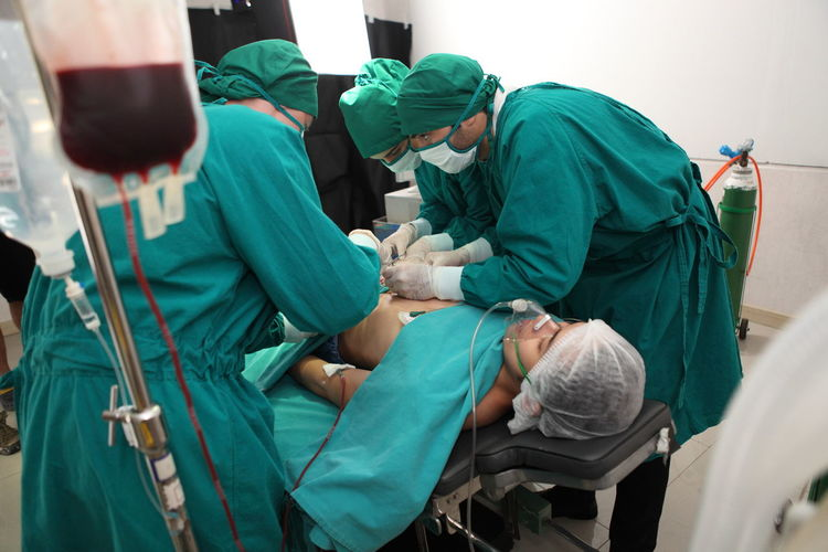 Doctors doing surgery on patient in hospital