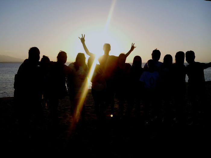 Team Friendship Sunset Silhouette Togetherness People Outdoors Vitality Fun Against The Light Against The Sun Teamwork Call Center Team Friendship Fun Celebration Sunset Vitality Summer Beach Party - Social Event Sunlight Togetherness Silhouette Sky Happiness