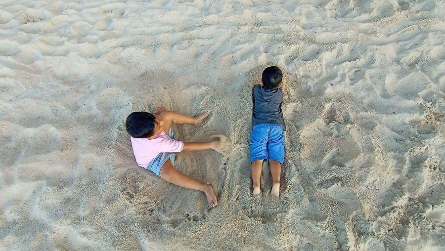 High angle view of boys on beach