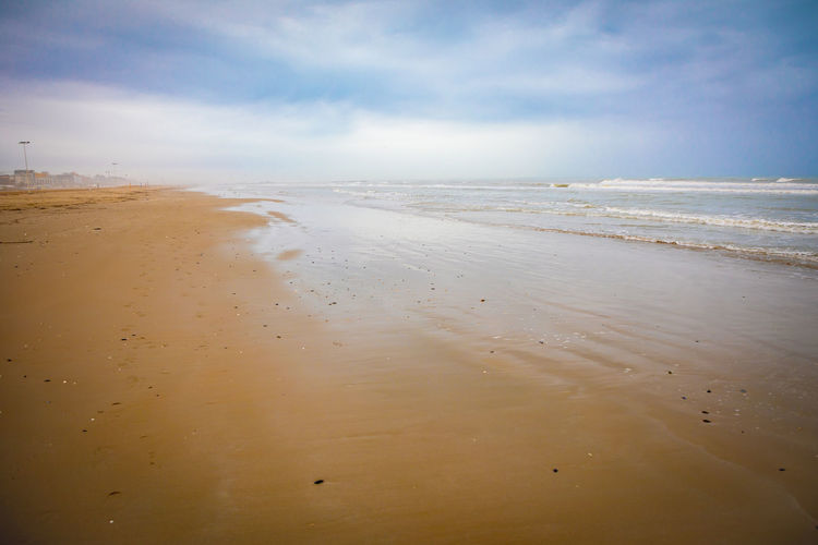 Water Beach Sea Land Sand Sky Beauty In Nature Scenics - Nature Tranquility Cloud - Sky Tranquil Scene Horizon Nature Horizon Over Water No People Non-urban Scene Outdoors Wet Day Low Tide