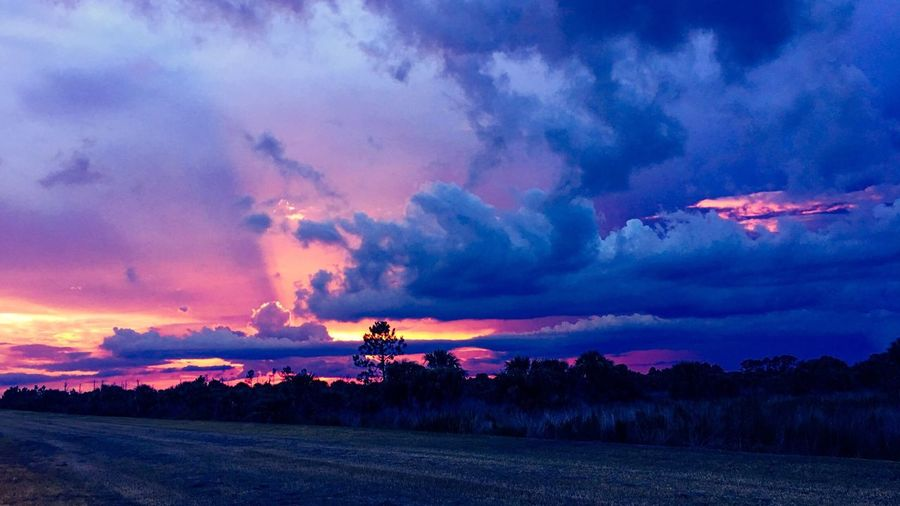 Colors Of The Night Sky After The Storm Dramatic Sky Cloud - Sky Sunset Beauty In Nature Nature Trees In The Distance Landscape Sky Scenics Tranquil Scene Tranquility No People Outdoors Field Agriculture Road Rural Scene Tree Day