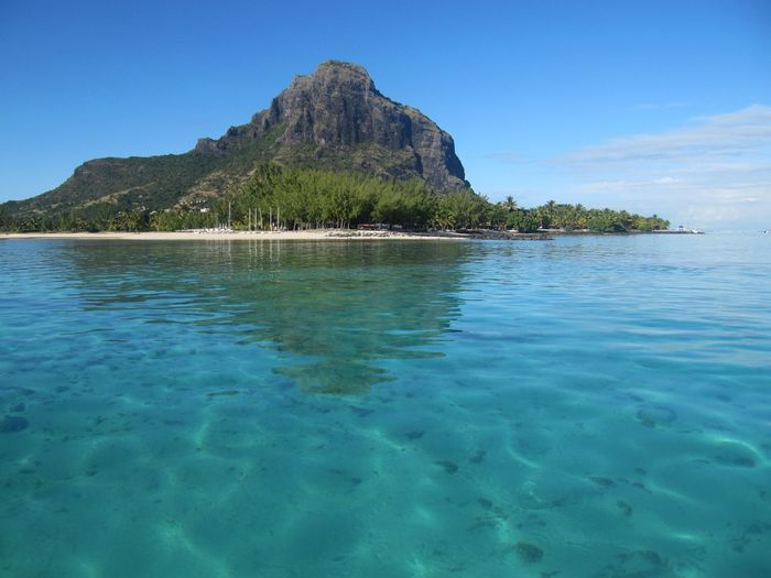 Mauritius Le Morne, Mauritius Island Indian Ocean Water Tree Clear Sky Sea Mountain Palm Tree Beach Blue Sand Summer Turquoise Colored Volcanic Rock Volcanic Landscape Rock Formation Lagoon Archipelago Rugged Geology