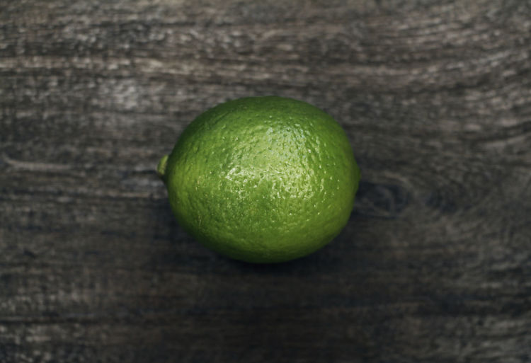Whole lime fruit shot on a wooden surface from above. Above Citrus Fruit Clean Eating Close Up Close-up EyeEmNewHere Food Food Photography Fresh Fresh Fruit Freshness Fruit Green Color Healthy Eating Healthy Food Ingredient Lime Macro Photography No People One Raw Raw Food Single Whole Lime Wooden
