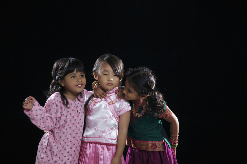 malaysia multi racial kids together on the black background Celebration Happiness Indian Traditional Clothing Black Background Child Childhood Chinese Emotion Flag Front View Group Of People Happiness Harmony Indoors  Innocence Malay Ethnicity Malaysia Malaysian Multi Racial Sister Smiling Standing Togetherness Women
