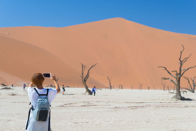 Person Photographing In Desert