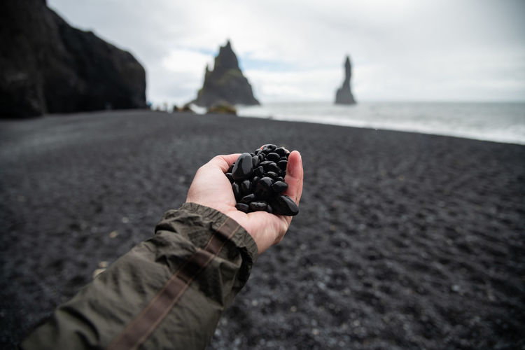 Black rocks on hand from black sand beach Reynisfjara Vik ,Iceland. Ice Rock Formation Basalt Basalt Rock Beach Blackandwhite Focus On Foreground Hand Icelandic Land Lavender Nature Reynisdrangar Reynisfjara Rock Rock - Object Sand Sea Volcano Water