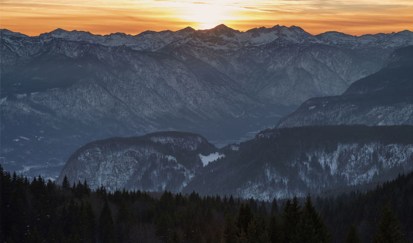 Winter view of Bohinj mountains from planina Zajamniki. Alps Cold Temperature Forrest Gorenjska Julian Julian Alps Landscape Landscape_photography Mountain Mountain Range Nature No People Outdoors Planina Scenics Slovenia Snow Sunset Winter Winter Winter Wonderland Wintertime WoodLand Woods Zajamniki