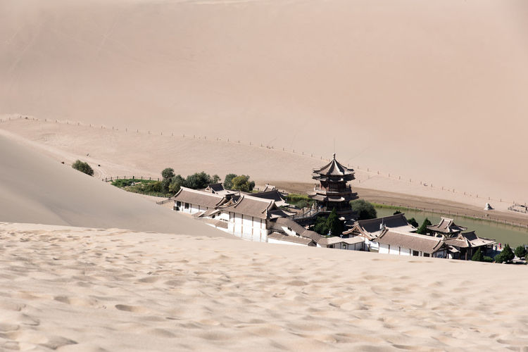The Singing Sand Dunes of Dunhuang, Gansu, China ASIA Architecture Dessert Gobi Desert Silk Road Architecture Beach Building Exterior Built Structure China Day Desert Design Gansu Landscape Nature No People Oasis Oriental Outdoors Place Of Worship Sand Sand Dune Sky Tranquility