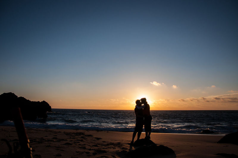 Couple kissing at a beach in Sintra Sea Sky Beach Water Land Sunset Real People Beauty In Nature Silhouette Leisure Activity Scenics - Nature Horizon Horizon Over Water Togetherness Two People Standing Nature Lifestyles Men Couple - Relationship Positive Emotion Outdoors Love