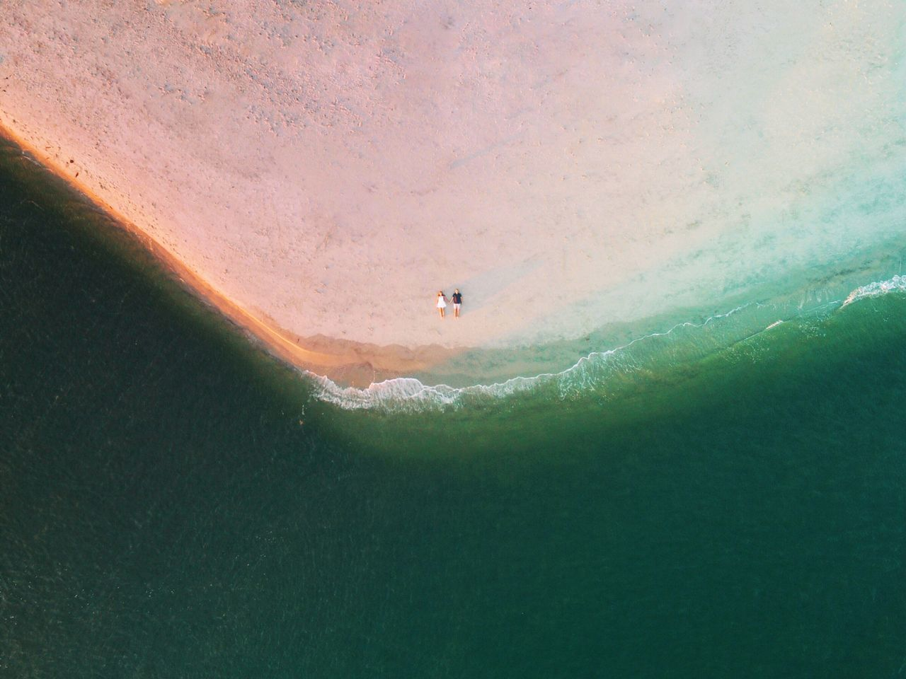 Aerial View Of Couple Lying On The Beach