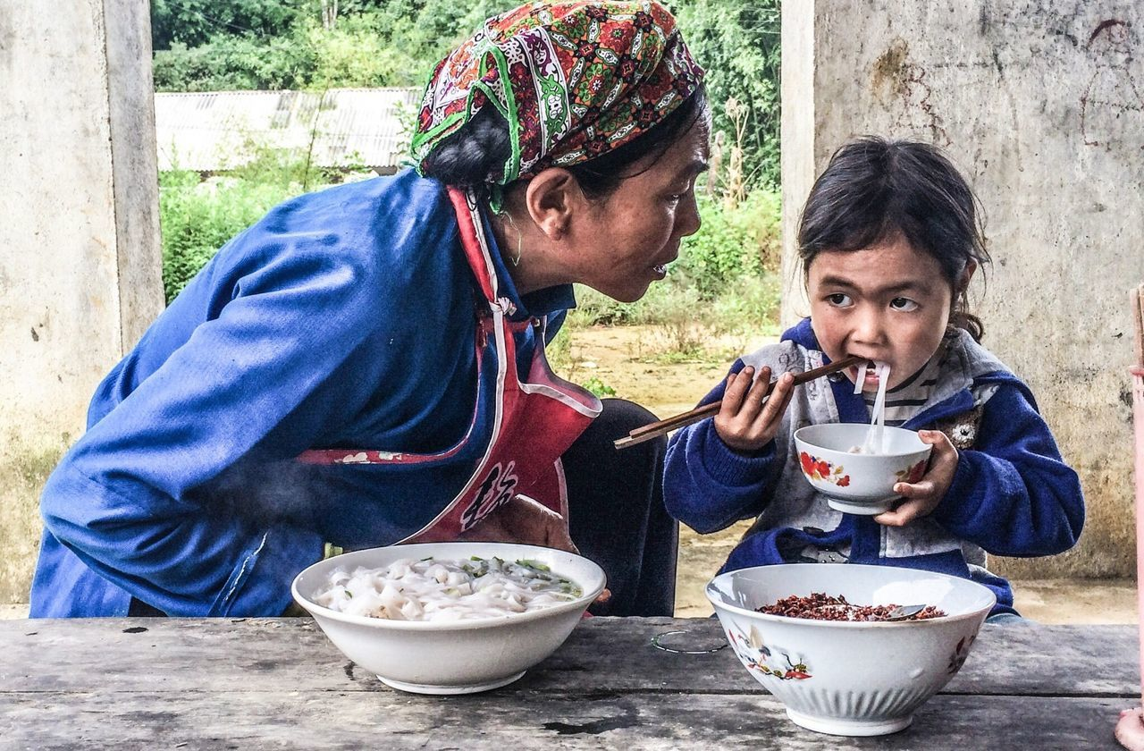 two people, bowl, sitting, togetherness, day, holding, childhood, real people, lifestyles, food, bonding, outdoors, close-up, people, adult, young adult