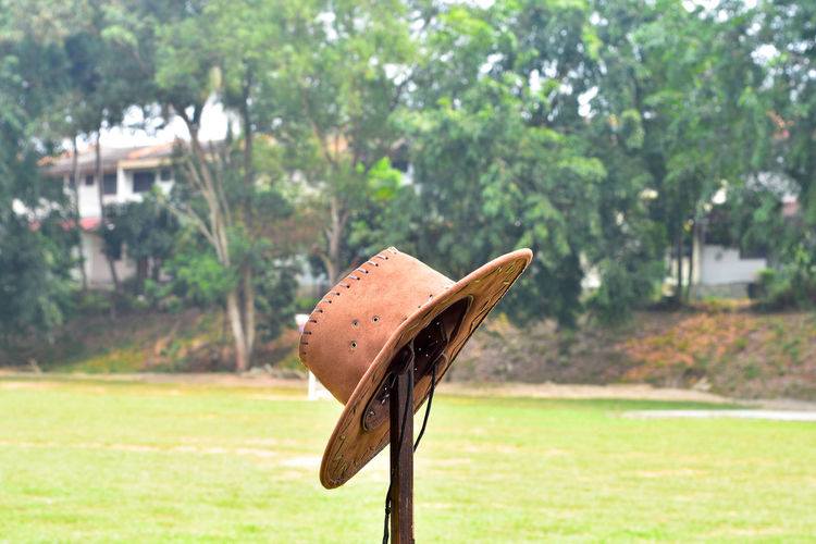 Cowboy hat Abandoned Beauty In Nature Close-up Cowboy Day Field Grass Green Color Growth Hat Leather Nature No People Object Outdoors Protection Tree Lieblingsteil