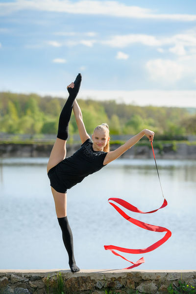 Athlete Caucasian Exercise Female Feminine  Girl Gymnast  Gymnastics Professional Rhythmic Ribbon Split Sport Sportive Teen Vertical Woman Young