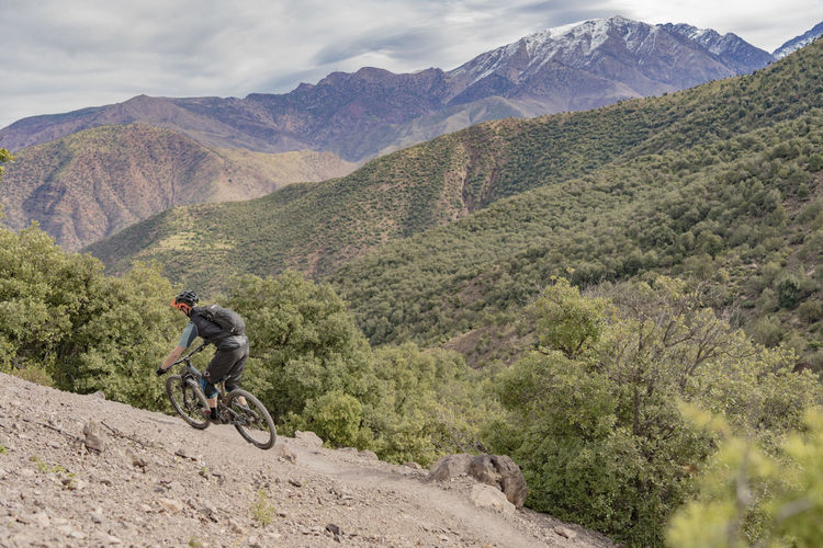 Mountain Mountain Range One Person Activity Leisure Activity Bicycle Riding Lifestyles Adventure Nature Ride Sport Travel Outdoors Mountain Bike Mountain Biker Mountain Biking Trail Vista View Morocco Athlete Fast Speed Beauty In Nature