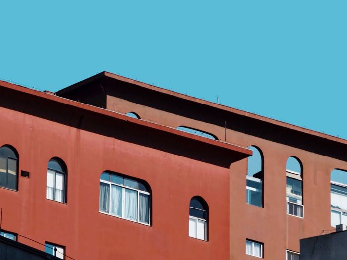 Light And Shadow Lines And Shapes Window Geometric Shape Colorful Urban Geometry Urban Landscape Urban City Life Building Exterior Architecture Built Structure Window Sky Building Clear Sky Blue Low Angle View No People Day Residential District Sunlight Red Outdoors Copy Space Roof House City 17.62°