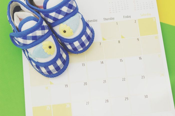 No People Multi Colored Yellow Close-up Baby Blue Shoes Baby Shoes Calendar Date Organize Plan Reminder Background Copyspace Family Planning Concept Conceptual Planner Contraception Fertility Ovulation Gender Calendar Method Method