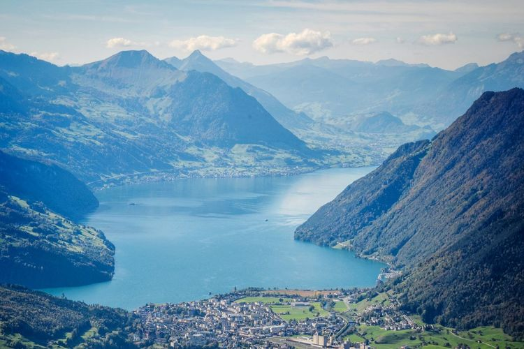 Scenic view of lake lucerne and mountains against sky